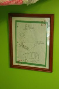 Simple way to display your child's artwork--the framed kids artwork decor idea that will make your kids smile and make your house even more beautiful | kid art | kid crafts | crafts by kids | art class | drawing | framed art | artwork display idea | simple room decor
