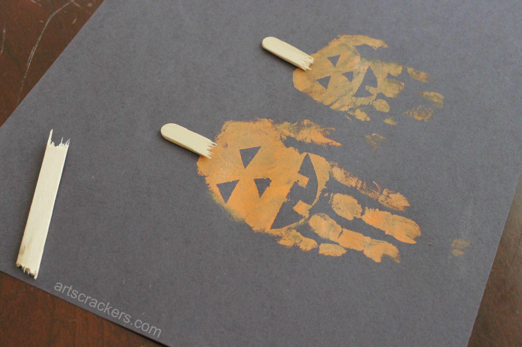 Fall halloween handprint jack o lantern pumpkin art for Pumpkin stems for crafts
