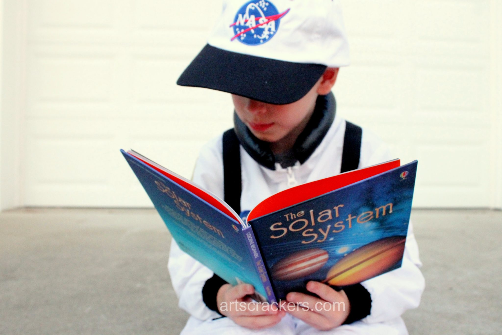 Jr Astronaut Reading Space Books. Click the picture to read the review.