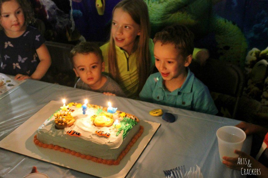 Aquarium Cake and Fish Cupcakes Lit Candles