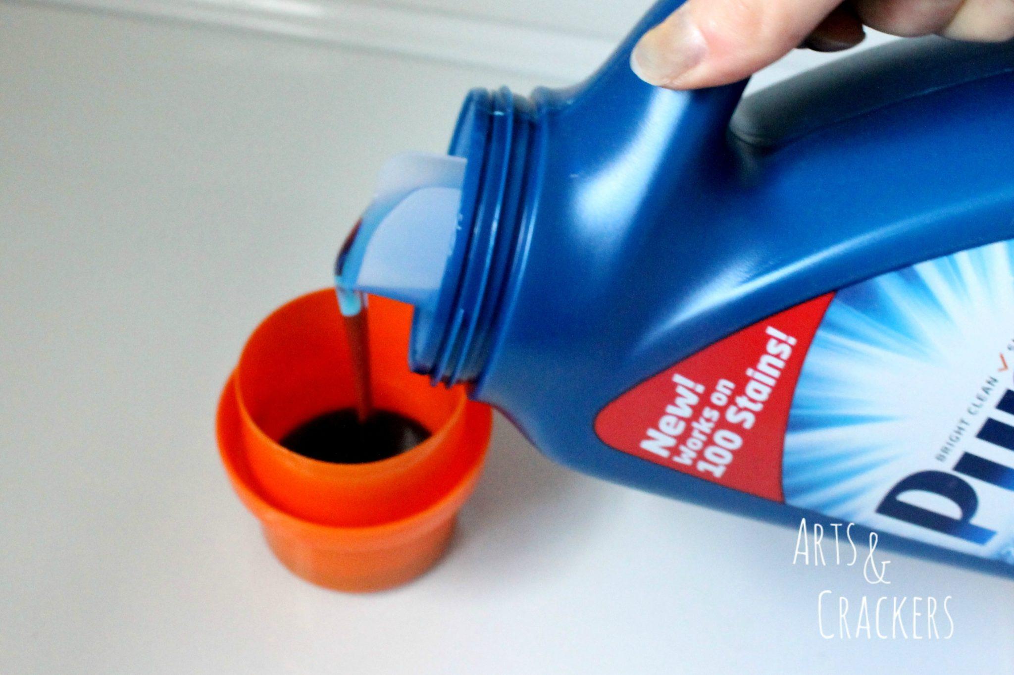 Purex Plus Clorox 2 Laundry Detergent Pouring