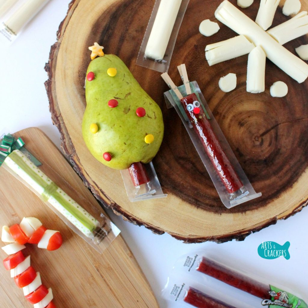 These Beef Stick and String Cheese Christmas Snack Ideas are sure to bring some Christmas magic to snack and lunchtime. | String Cheese Snack | String Cheese Wrapper | Christmas Snack Ideas | Christmas | Christmas Treat | Healthy Snacks | Snacks for Kids | Fun Lunch | Cute Snacks | Edible Crafts | String Cheese Wrapper Crafts | Reindeer Crafts | Candy Cane Snacks | Christmas Tree Snacks | Christmas Present Craft | Snowflake Snacks | Winter Treats | Lunch Box Ideas | Christmas Food for Kids