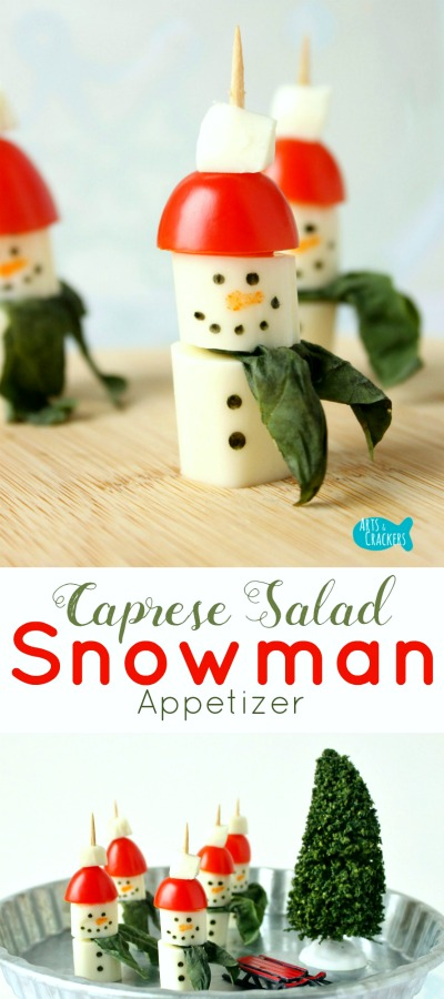 These String Cheese Snowman Caprese Salad Appetizers are simple to make and sure to be a hit for snack time or parties! Snowman | String Cheese | Winter | Winter Appetizer | Winter Snacks | Christmas Food | Snowman Food | Snowman Snack | String Cheese Snowman | String Cheese Snowmen | Caprese Salad | Salad on a Stick | Party Food | Appetizers | Healthy Snack | Snacks for Kids | Party Appetizer | Salad Recipe | Basil | Fun Food | Lunch Ideas | Edible Crafts