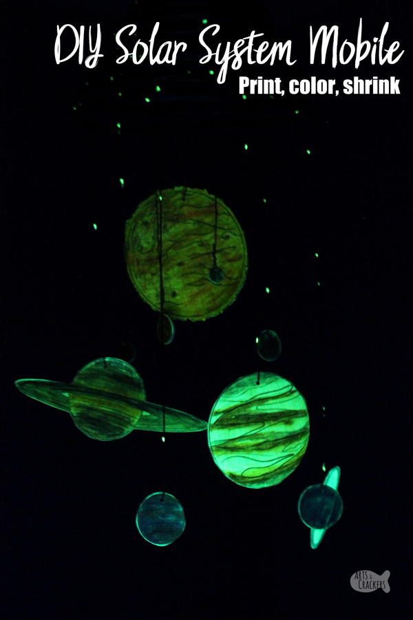 Make your own Glow-in-the-Dark Solar System Mobile with this Printable Shrink Art Template / Solar System Coloring Page. This Outer Space Home Decor really is out of this world | hanging mobile | educational activities | learning activities for kids | outer space decor | kids room decor | shrink paper | glow in the dark | glowing room decor | science decor | copper decor | planets