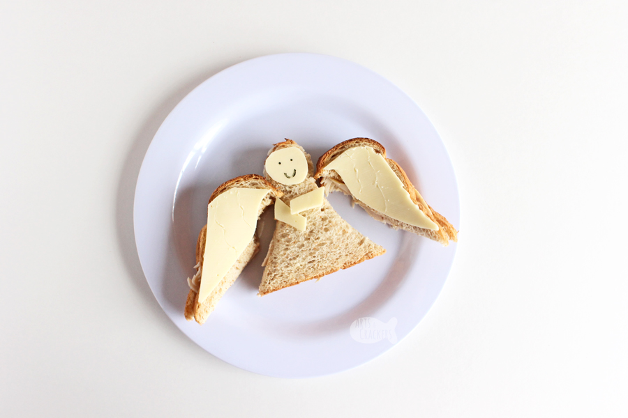 This Angel Sandwich Christmas lunch idea for kids is perfect for school lunch or lunch at home over winter break | shaped sandwich | angel shaped sandwich | angel food | angel crafts | fun food ideas | Christmas food #artscrackers #Christmasforkids #funlunchideas #lunchboxideas #creativefoodideas #pinterestmom #sandwiches #schoollunch #kidfriendlyfood #Christmasangel