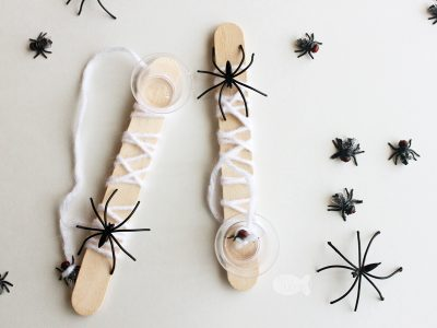 Make this fun cup-and-ball style Halloween Game, Spider Web Catch, as a Halloween activity or a non-candy treat for trick-or-treaters! #halloween #kidsactivities | Halloween Activity | Activities for Kids | DIY Crafts | Halloween Craft