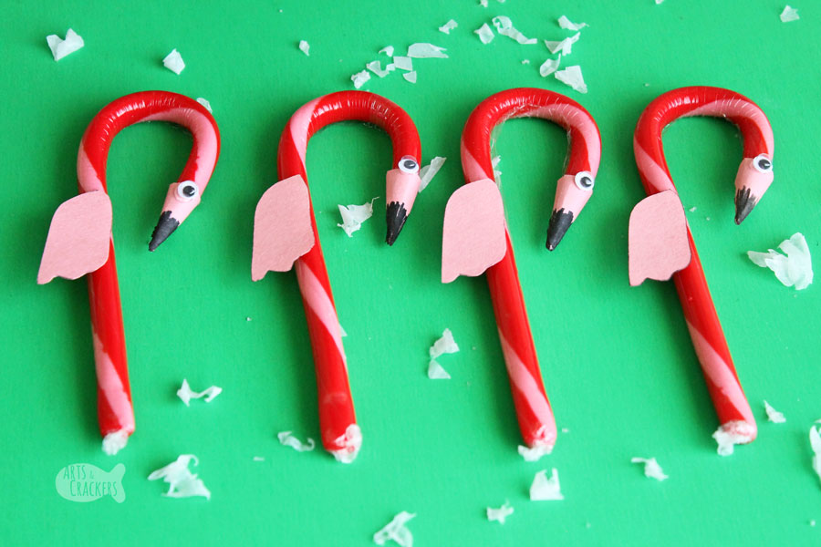 This cute DIY Flamingo Candy Cane Craft for Christmas is fun for a Hawaiian Christmas party or for our Alice in Winter Wonderland Christmas party theme | kid crafts | flamingo craft | candy cane treat | flamingo candy cane | edible flamingo treat | fun food ideas | edible craft | Christmas candy cane ornament | flamingo ornament #christmas #kidscrafts #flamingo