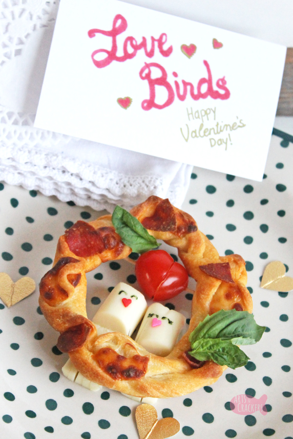 Share the love with these String Cheese Love Bird Pizza Wreaths, a cute Valentine's Day snack idea   Valentine's Day Food   String Cheese Snacks   String Cheese Craft   Fun Food Ideas   Edible Crafts   Lovebirds   Fun Food for Kids   Pizza Wreath   Valentine's Day Snacks for Kids   Valentine's Day Snacks for Adults   Pizza Appetizer   Valentines Appetizers #valentinesday #funfood #foodblog