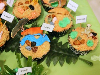 Decorate your own cupcakes with this zoo habitat themed cupcake bar | zoo party | zoo birthday | zoo cupcakes | zoo cake | safari cupcakes | DIY cupcakes | cupcake bar | zoo habitat activity | zoo activity | activities for kids | kids activity | kid birthday | birthday party activities | animal cupcakes | kid made food | kids in the kitchen | cupcakes for kids | kid cakes | #birthday #zoo #cupcakes #cakedecorating