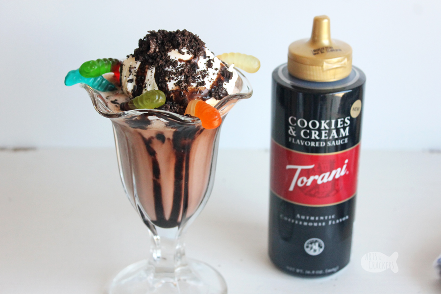 Taste the nostalgia of childhood with this decadent Dirt Cake Chocolate Shake — a Gluten Free Milkshake Recipe. You'll love the chocolate flavor, crunchy sandwich cookies, and chewy gummi worms in this frozen chocolate beverage | milkshake | gluten free recipe | dirt cups | chocolate pudding | oreos | frozen beverages | summer drinks | non-alcoholic drinks | blended drinks | chocolate #milkshake #dirtcake #foodblogger #recipe