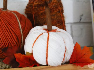 Decorate for fall with these adorable yarn pumpkins. Make this cute pumpkin decor with a yarn skein to make easy fall decorations for your home | DIY pumpkin decor | yarn skein crafts | fall crafts for the home | yarn pumpkins | no sew | yarn crafts for fall | fall home decorating | easy fall crafts | fall mantel | #yarncrafts #craftyfingers #autumncrafts #homedecor #pumpkins #yarn #DIYblogger